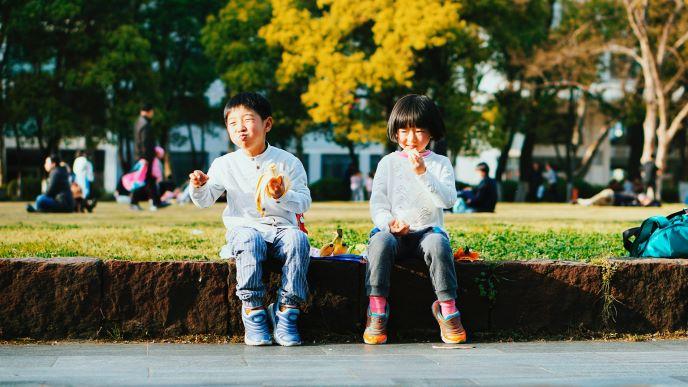 Children sat on wall eating